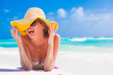Fototapety woman in bikini and straw hat having fun on tropical beach