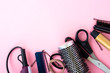 Hairdressing tools on a pink background
