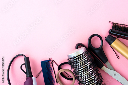 Hairdressing tools on a pink background Poster
