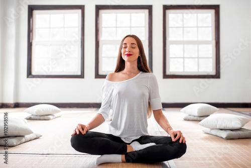 Woman practicing yoga indoors Plakát