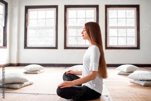Vászonkép Woman practicing yoga indoors
