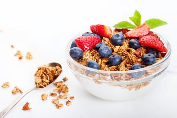 Healthy breakfast Fresh granola, muesli in bowl with milk and berries White background