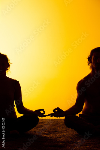 Fotobehang Jacht Two people practicing yoga in the sunset light
