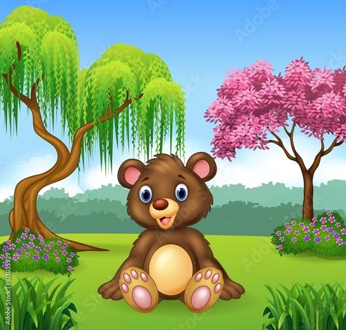 Naklejka Cute funny bear sitting in the jungle
