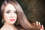 Fashion hairstyle. Beautiful woman with long straight hair