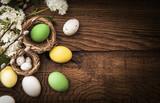 Fototapety Easter eggs on wood background