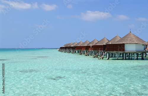 Beautiful overwater bungalows in a sunny day, Maldives