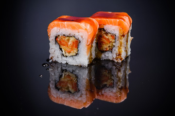 Sushi roll with salmon and sauce