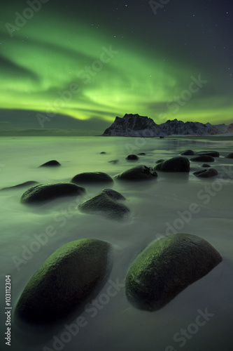 Obraz Aurora borealis over a beach on the Lofoten in Norway