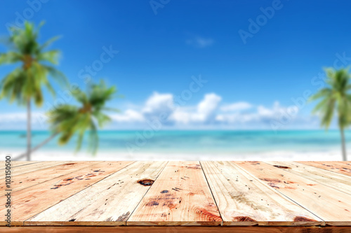 Papiers peints Tropical plage Top of wood table with blurred sea and blue sky background - Empty ready for your product display montage. Concept of beach in summer