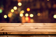 Empty wooden table for product placement or montage with focus to the table top, blurred bokeh background .
