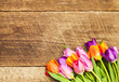 Colorful tulips on wooden board. Happy mothers day. Spring time