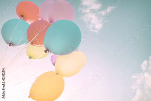Colorful balloons in summer holidays. Pastel color filter Poster