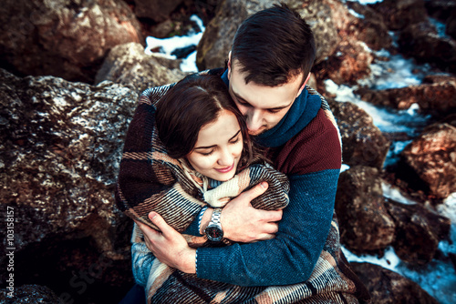 Poster Young happy couple outdoor on the stones