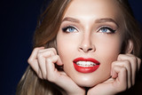 beautiful girl with red lips with hands near the face