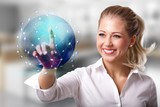 businesswoman touching a holographic globe