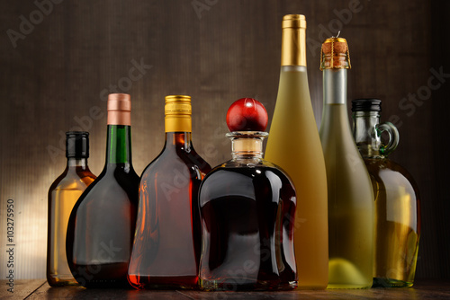 Bottles of assorted alcoholic beverages Poster