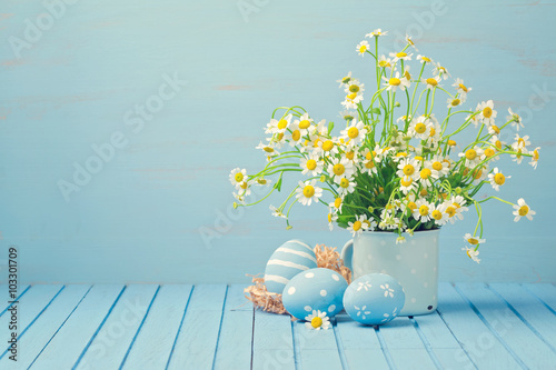 Easter holiday decoration with daisy flowers and painted eggs on wooden blue tab Poster