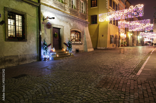 Fototapeta Street in Old Town of Warsaw by Night