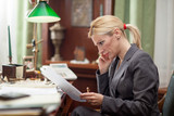 businesswoman sitting at a table in the office and working - 103353985