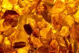 closeup baltic amber stones lie on a flat surface - Fine Art prints