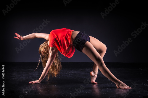 Poster beautiful ballet dancer posing on black studio background