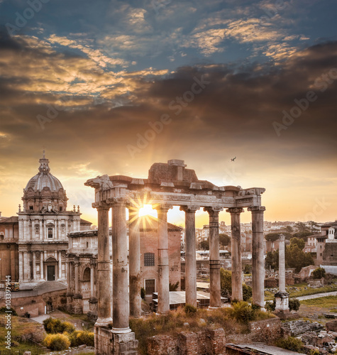 Poszter Famous Roman ruins against sunrise in Rome, Italy
