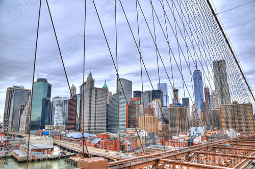 The skyscrapers in downtown Manhattan from the Brooklyn bridge in HDR on a winter day