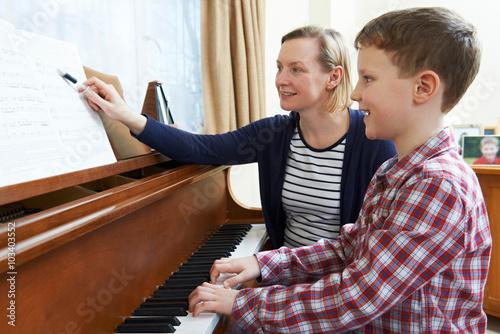 Fototapeta Boy With Music Teacher Having Lesson At Piano