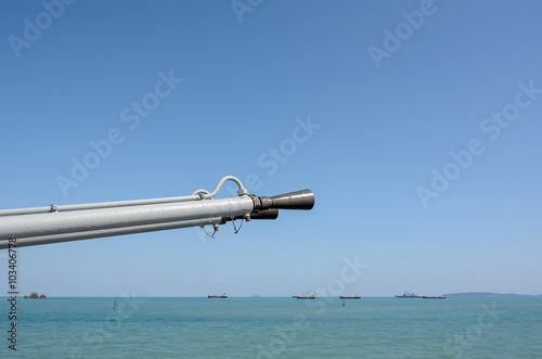 Army gun on the boat with sea and sky background,close up on gun Poster