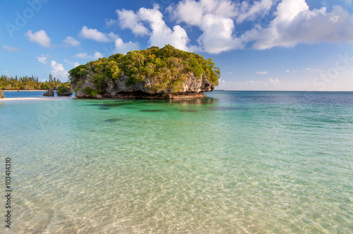 Tropical beach with a rock in the water, Isle of Pines, New Caledonia