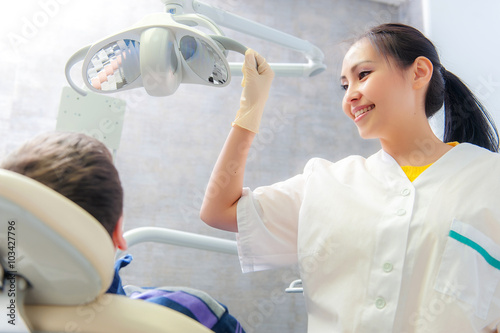 Poster Portrait of a friendly dentist in dental clinic