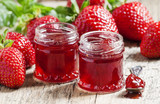 Strawberry confiture with whole berries and fresh strawberries o
