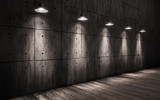 industrial grunge background illuminated ceiling lamps, large dark room with walls made of concrete and wooden floors - 103465351