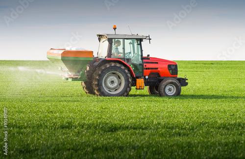 Poster  tractor fertilizing in field