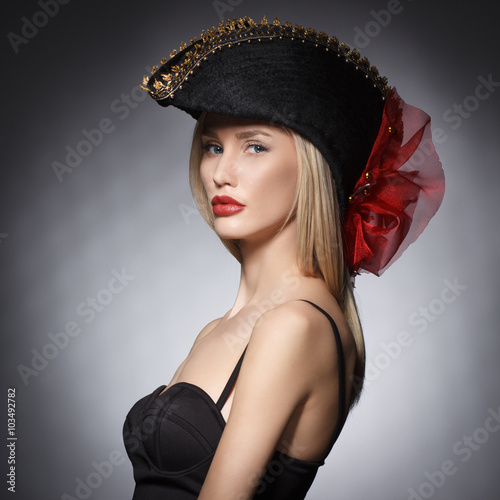 Luxury blonde young woman in a stylish black hat