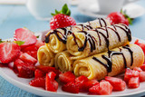 rolled pancakes with strawberries and chocolate breakfast