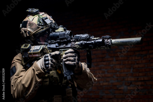 Spec ops soldier in uniform with assault rifle/man in military uniform with assa Poster