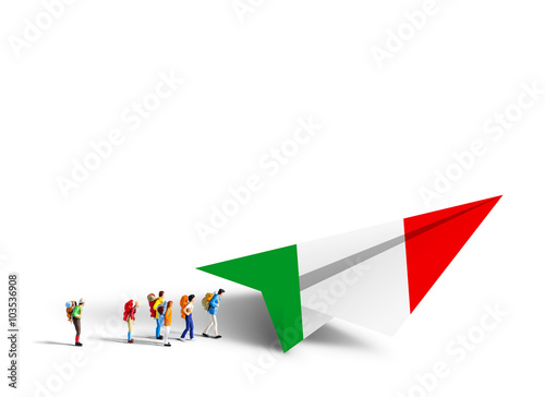 Poster Miniature backpackers walking to the paper italy airplane on whi