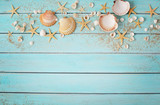 seashells and sand on wooden background - 103562330