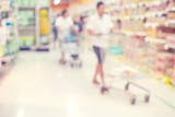 Fototapety Abstract blurred interior of supermarket with people shopping background - vintage retro color filter