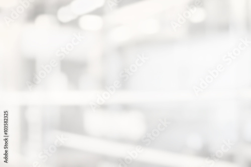 abstract white and gray bokeh lights background with motion blur