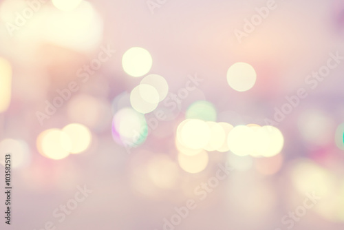 Fototapeta Abstract light bokeh with blur background - vintage color tone filter effect