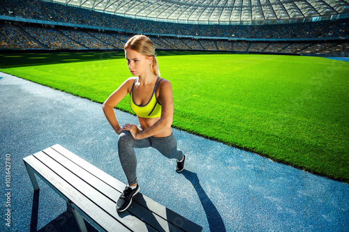 fototapeta na ścianę Young sportswoman is at large modern stadium