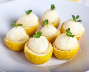 Lemon sorbet or ice cream inside fresh lemons