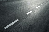 White dotted line on city asphalt road background. - 103678346