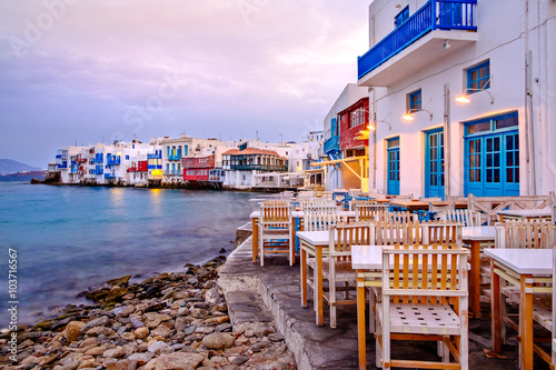 Fotobehang Purper Beautiful sunrise at Little Venice on Mykonos island, Greece