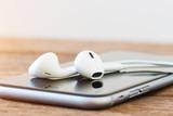 Fototapety closeup phone and headphone device on table