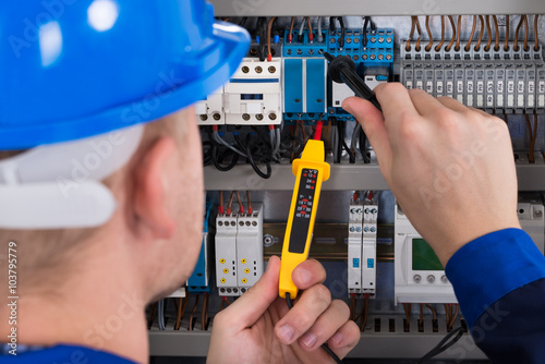 Poster Male Electrician Checking Fusebox