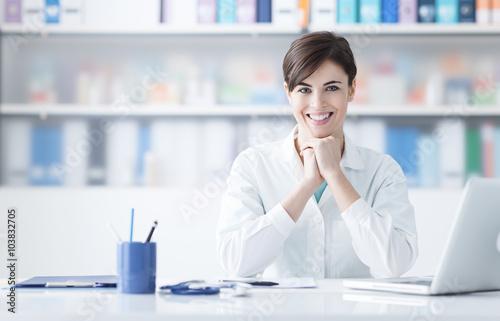 Doctor working at office desk Plakat